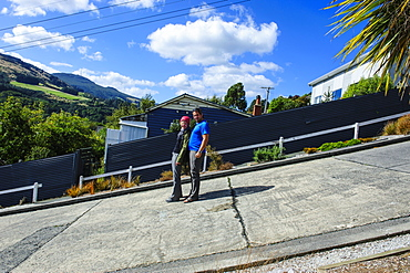 Tourists standing on Baldwin Street, the world's steepest residential street, Dunedin, Otago, South Island, New Zealand, Pacific