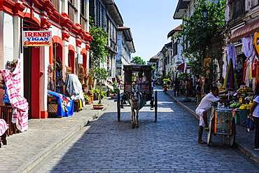 Horse cart riding through the Spanish colonial architecture in Vigan, UNESCO World Heritage Site, Northern Luzon, Philippines, Southeast Asia, Asia