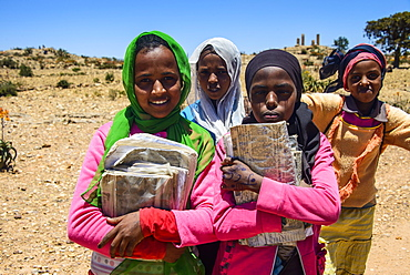 Colourfully dressed schoolgirls on their way home at the Pre-Aksumite settlement Qohaito, Eritrea, Africa