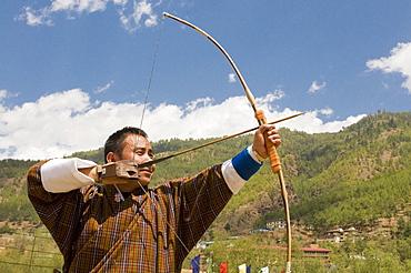 Man practising the national sport of archery, Thimpu, Bhutan, Asia