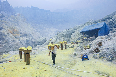 Fully loaded baskets of sulphur ready to be carried  out of the Ijen Volcano, Java, Indonesia, Southeast Asia, Asia