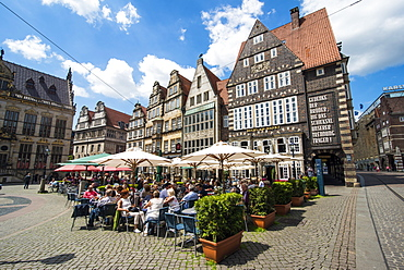 Beer garden in front of old Hanse houses on the market square of Bremen, Germany, Europe