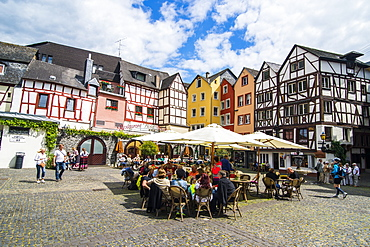 Restaurant in front of half timbered houses in Bernkastel-Kues, Moselle valley, Rhineland-Palatinate, Germany, Europe