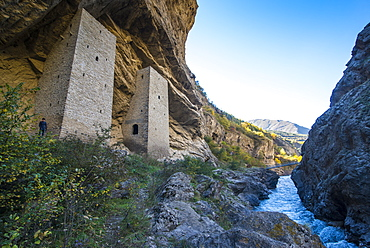 Chechen watchtowers in an overhanging cliff on the Argun River, near Irum Kale. Chechnya, Caucasus, Russia, Europe