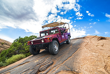 Hummer driving on the Slickrock trail. Moab, Utah, United States of America, North America