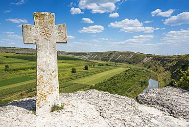 Old Christian cross above the historical temple complex of old Orhei (Orheiul Vechi), Moldova, Europe