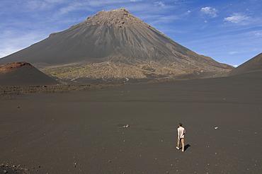 Man walking towards volcano on Fogo, Cape Verde Islands, Africa
