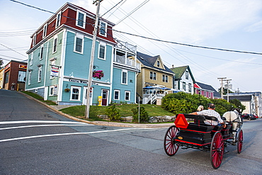 Horse cart riding historical style in the Old Town, Lunenburg, UNESCO World Heritage Site, Nova Scotia, Canada, North America