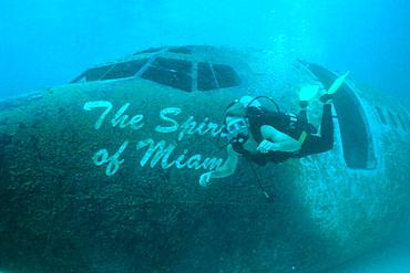 Diver 'flies' next to airplane wreck off Miami Beach, Florida, USA
