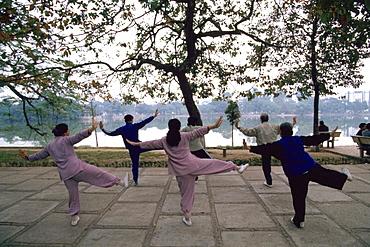 People exercising by Lake Hoan Kiem, Hanoi, Vietnam