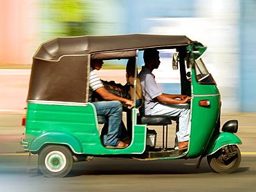 Three wheeled motorized taxi, known as an autorickshaw, in Colombo, Sri Lanka