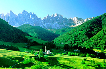Village of Santa Magdalena in in the Odles Mountains (Val di Funes), Dolomites at the background, Alps, Italy