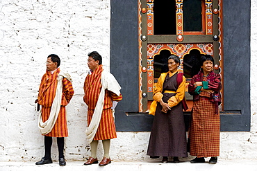 Bhutan, Thimpu, Thimpu Dzong Monastery, Buddhist Festival (Tsechu), Bhutanese men and womenl