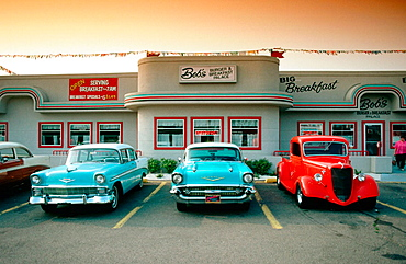 56 and 57 Chevys in front of Burger place, Erie, Pennsylvania, USA