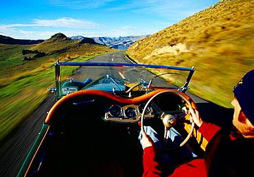Driving along the Summit Road Port Hills Christchurch New Zealand