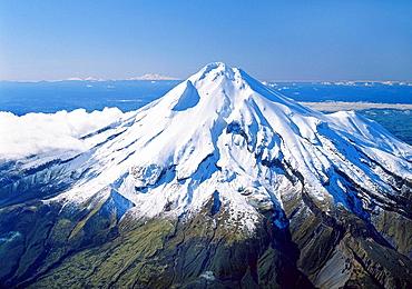 Mount Taranaki / Egmont with Mts Tongariro Ngauruhoe and Ruapehu in distance left New Zealand