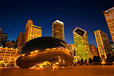 Illinois, Chicago, Cloud Gate sculpture in Millennium Park at night, city skyline, known as the Bean