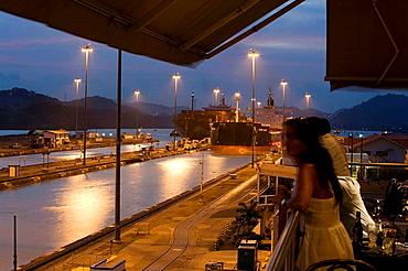 'Panamax' dimensions cargo ships transiting the Panama Canal at Miraflores locks, Panama