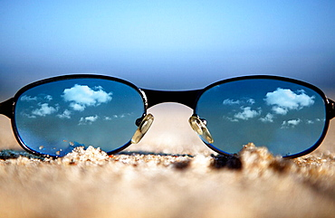 Glasses reflecting blue sky