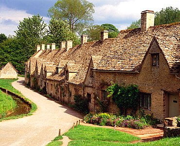 Cottages along Arlington Row in Bibury, The Cotswolds, Gloucestershire, England