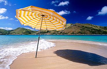 Umbrella on the beach of Ille Pinel, Sint Maarten (Saint Martin), Caribbean