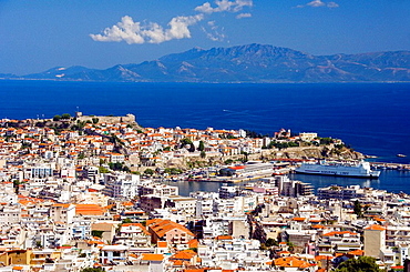 The city of Kavala with its fortress, port and island of Thassos, Greece in the distance
