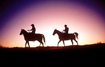 Rancher couple on horseback