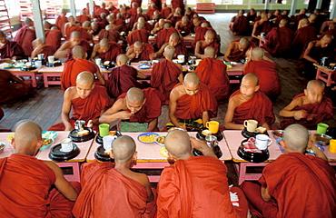 Buddhist monks eating inside a temple, Amarapura, Mandalay region, Myanmar