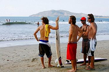 Surfers on Tamarindo beach, Nicoya peninsula, Costa Rica