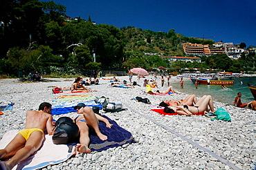 People on the beach at Isola Bella island, Taormina, Sicliy