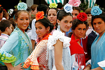 Young women wearing traditional flamenco dress at the April Fair, Seville, Spain