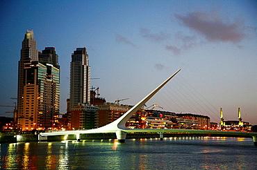 Night view over Puerto Madero and the Puente de la Mujer bridge Buenos Aires, Argentina