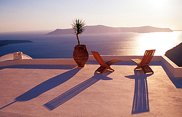 Outdoor cafe at late afternoon, Thira village, Santorini Island, Greece