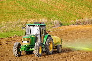 Tractor spraying field, Axarquia, Malaga province, Andalucia, Spain
