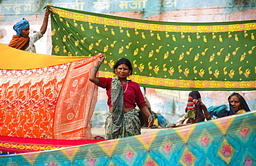 Women drying saris after holy bath in the Ganges, Kumbh Mela Festival (2001), India