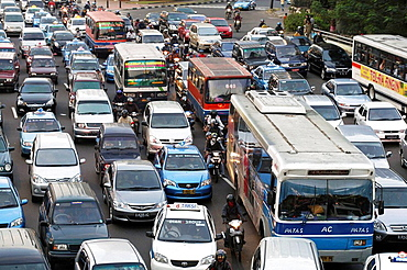 Traffic jam during the evening rush hour when everybody goes home on the main thoroughfare of Jakarta, Jalan Sudirman, in the heart of the business district, Jakarta, Southeast Asia