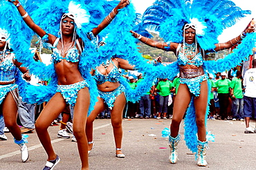 Women dancing on the street and wearing Carnival costume, Trinidad Carnival, Queens Park Savannah, Port of Spain, Island of Trinidad, Republic of Trinidad and Tobago