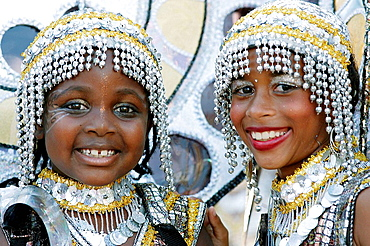 Two kids at the kids parade with Carnival costumes at the Trinidad Carnival, Queens Park Savannah, Port of Spain, Island of Trinidad, Republic of Trinidad and Tobago