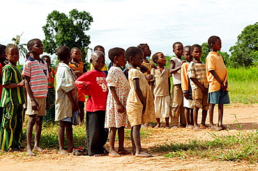 School kids standing outside, in line during during their sport classes and waiting for their turn, Nampula province, Mozambique, Southern Africa
