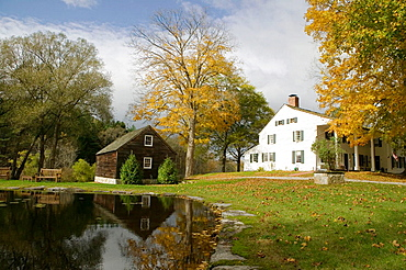 Bed and Breakfast Inn with Greek-revival architecture next to pond, Bennington, Vermont, United States