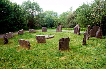 Circle of standing stones, recreation of an old Celtic village, Irish National Heritage Park, Ferrycarrig, Co, Wexford, Ireland