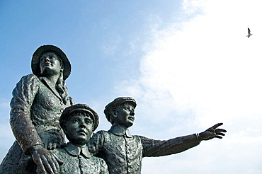 Statue of fifteen year old Annie Moore and her two younger brothers who left Queenstown (Cobh) on the 20th of December 1891, They sailed on the steamship Nevada to New York to join their parents, Cobh station, Cork, Ireland