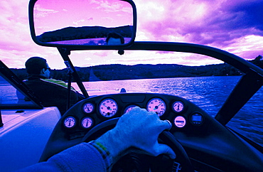 Driver POV in boat on lake in New Hampshire