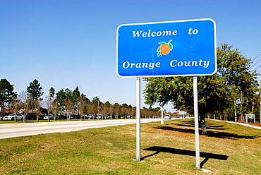 County road sign Welcoming Drivers to Orange County Kissimmee Orlando Disney Theme Park Area, Florida, USA