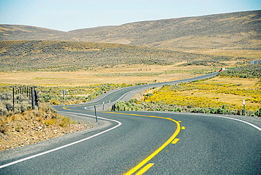 Highway in Wyoming farm country ranch land expanse vast agriculture cattle WY US United States