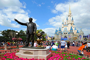 Statue of Walt Disney and Mickey Mouse in front of Cinderella Castle at Magic Kingdom Theme Park Orlando Florida Central