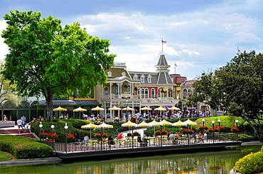 Cafe with yellow umbrellas at Walt Disney Magic Kingdom Theme Park Orlando Florida Central