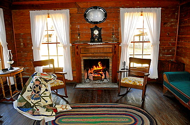 Living Room with fireplace in Carlton House Circa 1885 from Wauchula Florida at Cracker Country Florida living history museum located on the Florida State Fairgrounds Tampa