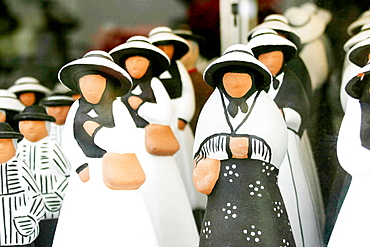 Ceramics figures showing the island traditional costumes, Formentera, Balearic Islands, Spain
