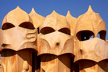Detail of the fanciful chimney pots at the top of La Pedrera or Casa Mila in the city of Barcelona, Catalonia, Spain